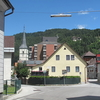Bad Eisenkappel, View Of A Street With A Church Tower