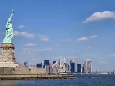 Statue With Manhattan In The Background