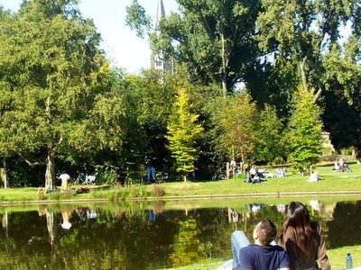 People Relaxing Near A Pond In The Vondelpark