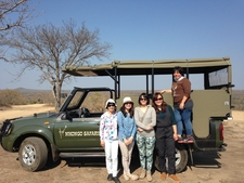 Some Guests In Front Of Open Safari Vehicles