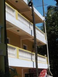 Looking Up At Balconies Facing Pool At Hote