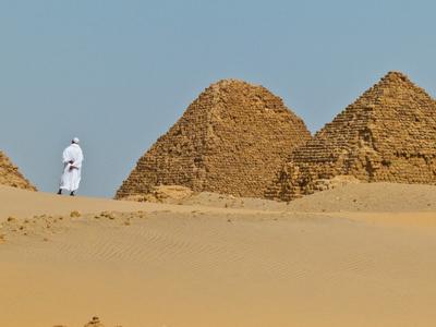 A Man Walks Among The Pyramids