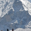 Trekkers Against A Snow Covered Island Peak