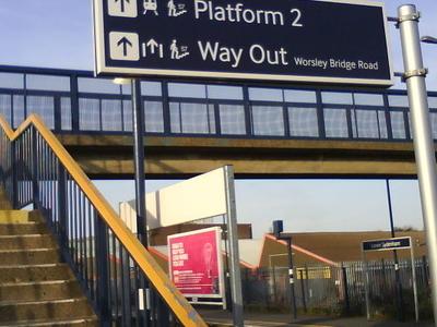 Platform Information Sign And Footbridge