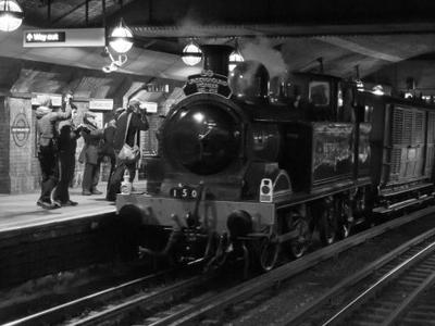 Original Metropolitan Steam Train Passes Through Station