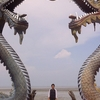 A Visitor Of Sanggar Agung Temple Toke A Picture Under The Dragon Statues 2 C Surabaya Indonesia