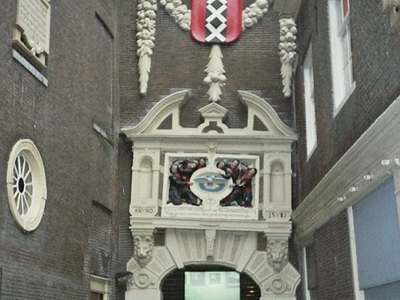 The Coat Of Arms Of Amsterdam Above The Entrance