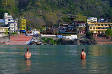 Travelers Taking A Dip In The River Ganges Rishikesh