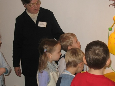 The Guide And Children In The Toy Museum