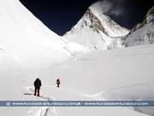 Trekkers Passing Through The Gasherbrum Glacier With Peak Gasherbrum Iv Ahead 7925 M Karakoram Pakistan