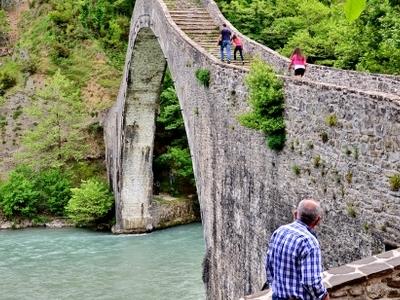 Plaka Bridge Crossed By Tourists