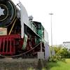 A Vintage Steam Locomotive At The Entrance Of Tiruchirappalli Junction