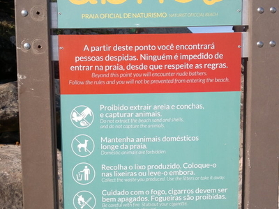 An Entrance Board With The Rules Of Abricó Nude Beach