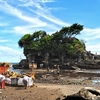 Priests Are Presnting Offerings At Tanah Lot Temple, Bali, Indonesia