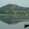 Nigeen Lake With The Hari Parbat Hill In The Background