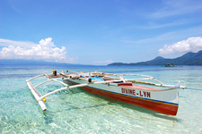 An Outrigger Canoe Over The Clear Waters Of White Island