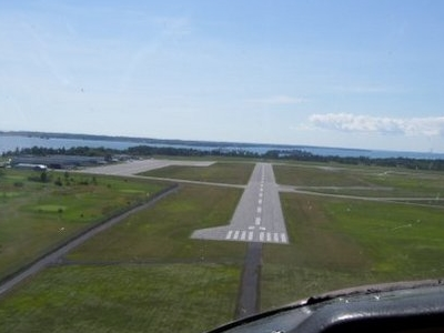 On Approach To Runway 25 In A Cessna C-150