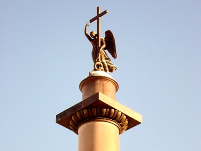 The Top Of The Column Showing Statue