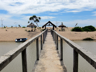 Bridge Across Lagoon To Beach