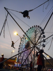 Bungee Trampolinists In Front Of The Kaohsiung Eye