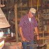 Working Blacksmith At Flying W