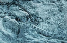 Climbing Up Seljalandsfoss In Winter