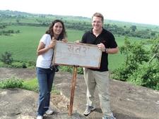 Ann & David Urmann With A Danger Sign