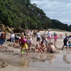 Visitors Making Small Pools By Excavating Sand At Hot Water Beach