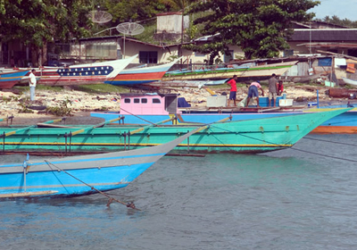 Fishing Boats Lined Up At Kota Biak