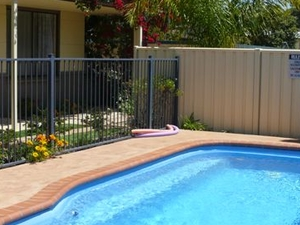 Front Of Sandpiper Holiday Apartments Units Merimbula  From Puddle