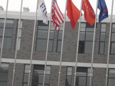 The Flagpoles At The FIU School