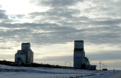 Grain Elevators By Railway Track