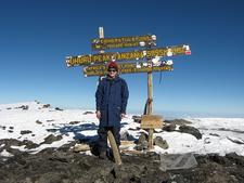 Hiker Atop Uhuru Peak - Kilimanjaro