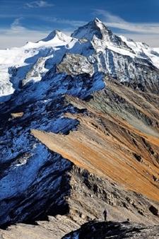 Hiker Below Dent Blanche In Swiss Alps