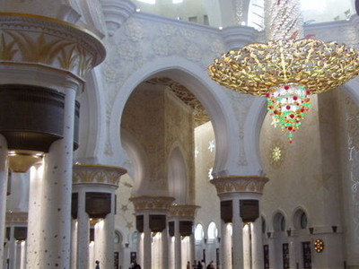 Interior Showing The Archways The Chandelier And The Carpet.