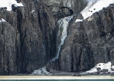 Jan Mayen Waterfall From A Melting Glacier