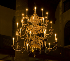 An Antique Chandelier Lighting Up The Synagogue