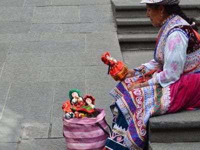 Lady Selling Handmade Puppets