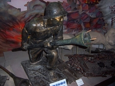 A Statue Of A Viet Minh Soldier Holding A Lunge Anti-Tank Mine