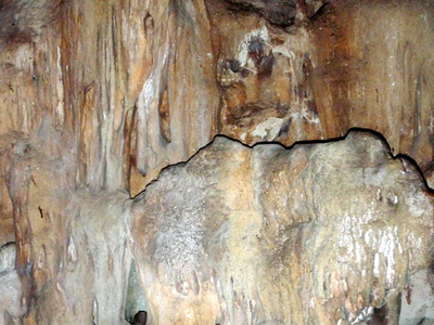 Left Graphic Indian Paintings In Fontein Cave. Right Stalagmites