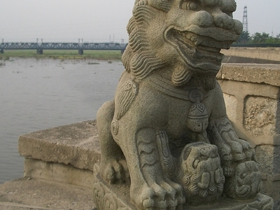 Stone Lion With A Cub