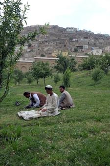 Men Praying At Babur Gardens