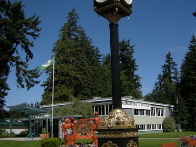 Municipal Building And Street Clock With Memorial Park In Backgr