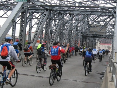 Bicyclists Crossing The Bridge