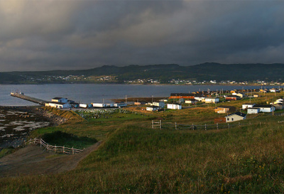 Rocky Harbour At Sunset