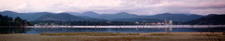 Panorama Of Coeur Dalene From Cougar Bay. The Tall Building To T