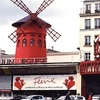 The Moulin Rouge On The Boulevard De Clichy