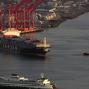A Container Ship And The Bainbridge Island Ferry Near Terminal