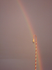 Rainbow Behind Candy Cane Streetlight At North Pole