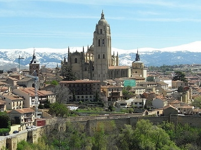 Segovia Amid Snow-Covered Mountains In Spain